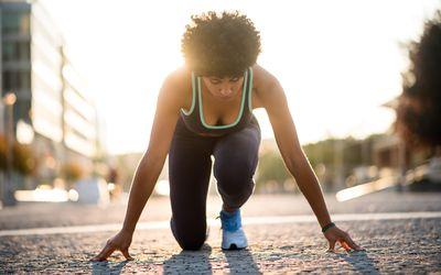 Sprinter woman at start position, Ready to run