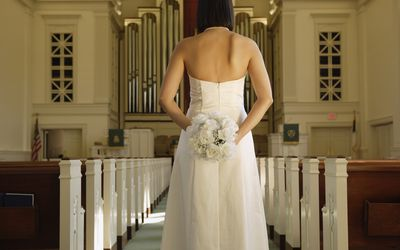Bride standing in a church.