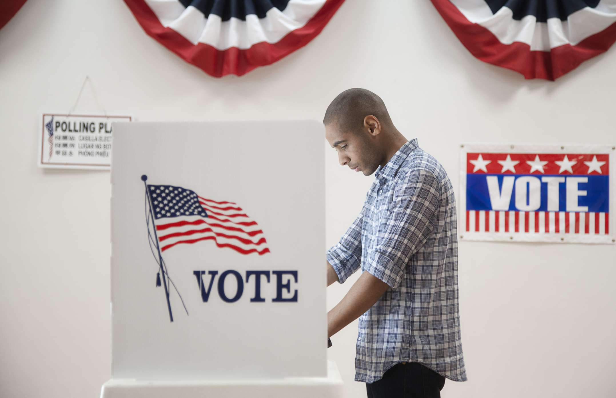 Man voting in polling place