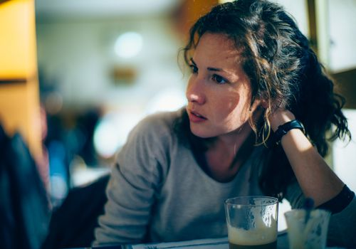 Concerned woman in coffee shop