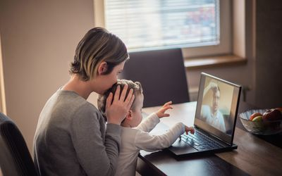 Woman with baby chatting with divorced dad online.