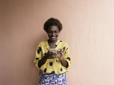 Woman smiling at her phone.
