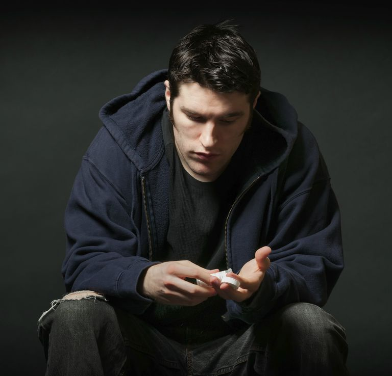 Depressed Young Caucasian Man Holding Prescription Medication
