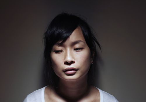Young Asian Woman Looking Sad