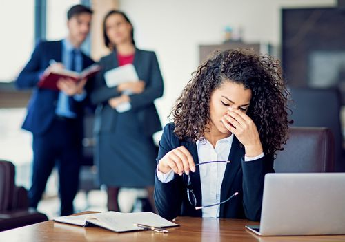 Burnout businesswoman under pressure in the office