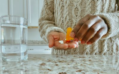 Woman pours pills into her palm