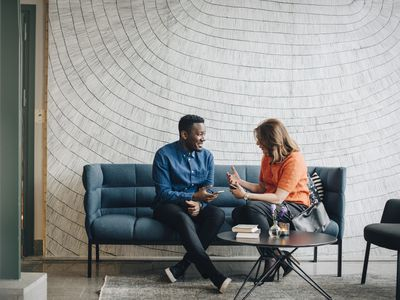 Man and woman having conversation on a couch