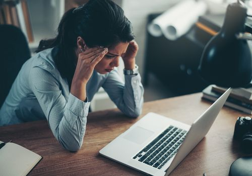 Business woman experiencing anxiety