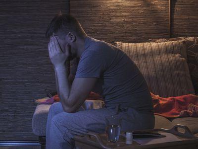 Sad man depressed in his room
