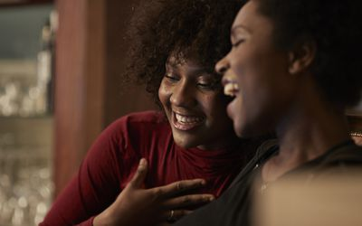 two young women laughing together