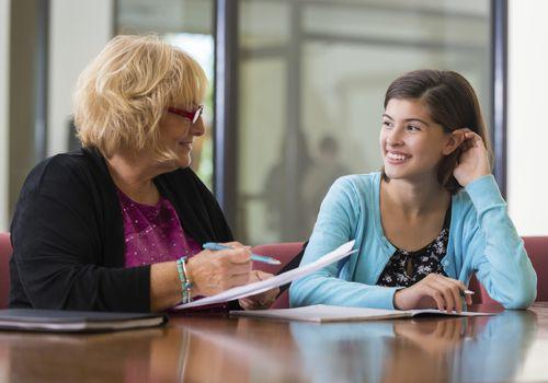 Teacher smiling at a tween girl
