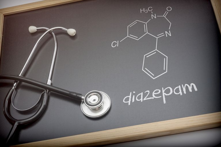 Chemical formula of diazepam written with chalk on a blackboard next to a stethoscope, conceptual image