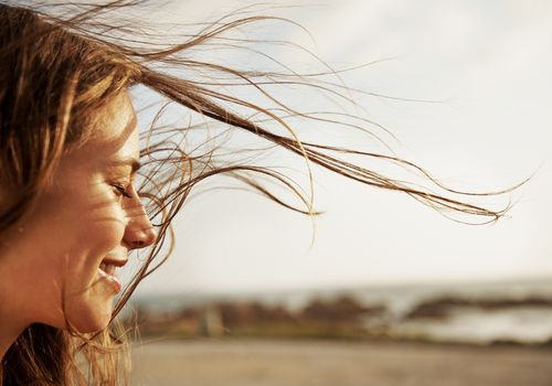 Woman with the wind in her hair smiling