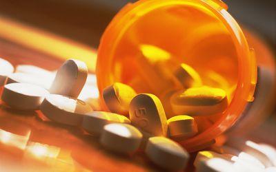 Prescription pills spilling out of pill bottle
