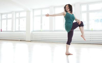 Woman stretching in a studio