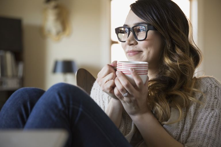 Smiling woman enjoying coffee