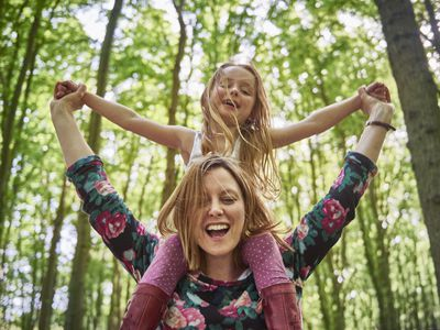 Woman with daughter on her shoulders