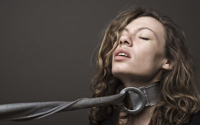 woman with belt around neck autoerotic asphyxiation