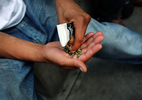 Man holding Synthetic Marijuana