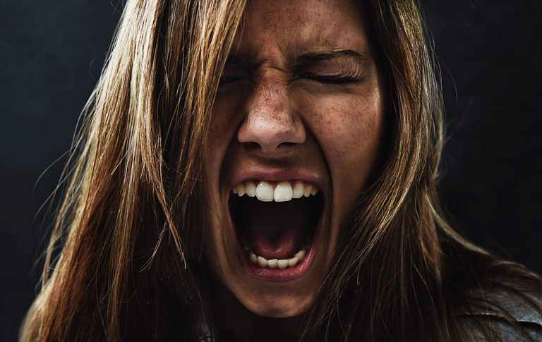 Woman experiencing angry emotions