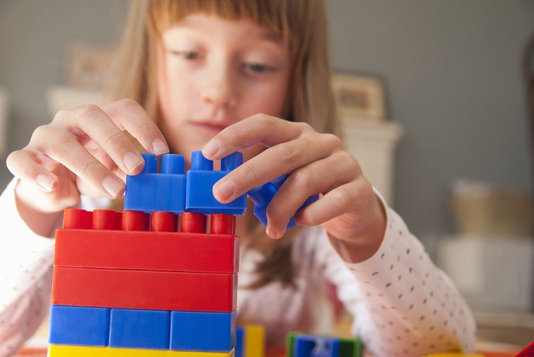 Girl stacking blocks