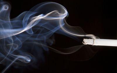 cigarette smoke on a black background