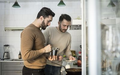 couple preparing food in kitchen at home