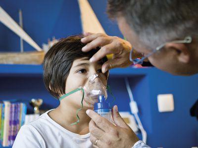 Boy receiving oxygen treatment