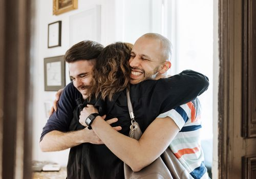 Gay Couple Welcoming Their Mother At The Door