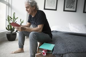 Depressed man opening a gift