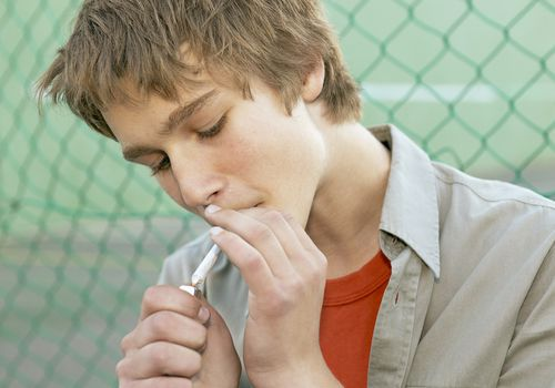 Teen Boy Smoking Joint