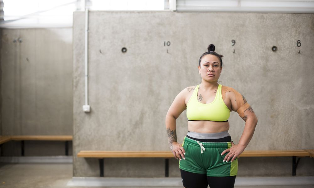Strong woman in workout clothes