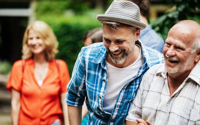 Man Laughing With Father During Family BBQ