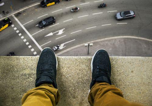 Man overlooking street
