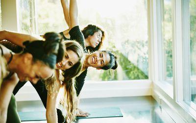 women friends enjoying yoga class