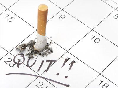Quit date and cigarette butt on a calendar