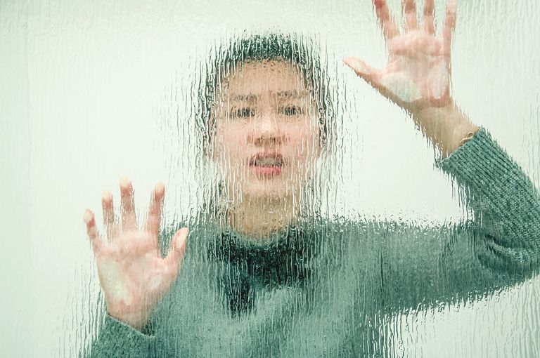 Woman Behind Transparent Wall