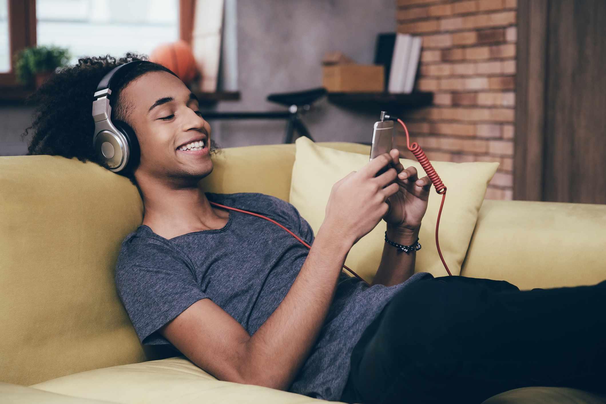 Teen boy listening to music