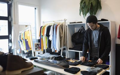 Man straightening out clothing