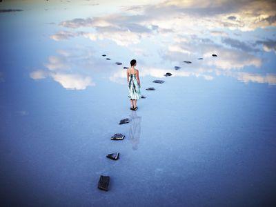 Woman in surreal landscape