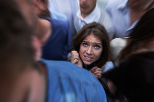 Scared woman in a crowd