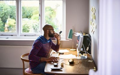 Man working at home on computer