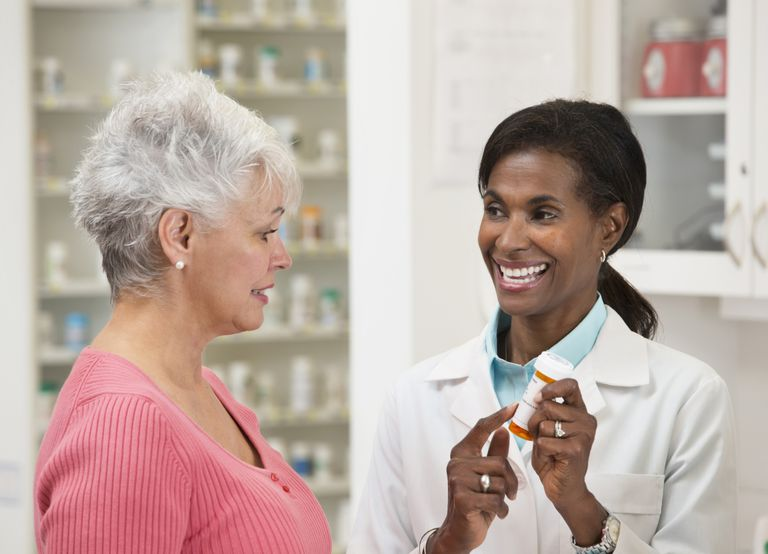 Pharmacist serving customer in pharmacy
