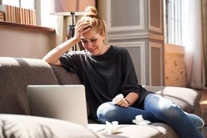 woman crying while on laptop