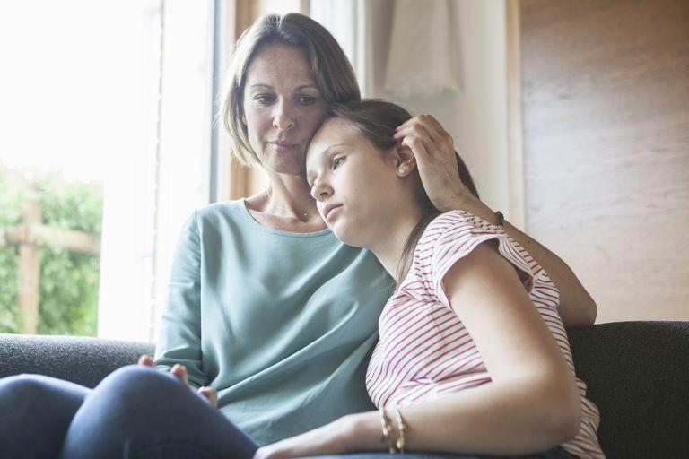 woman comforting teenage daughter
