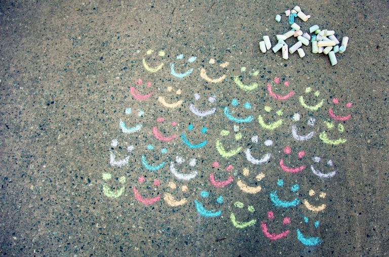 Smiley faces drawn with chalk on the street