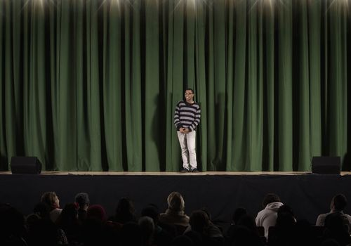 Student performing on high school stage