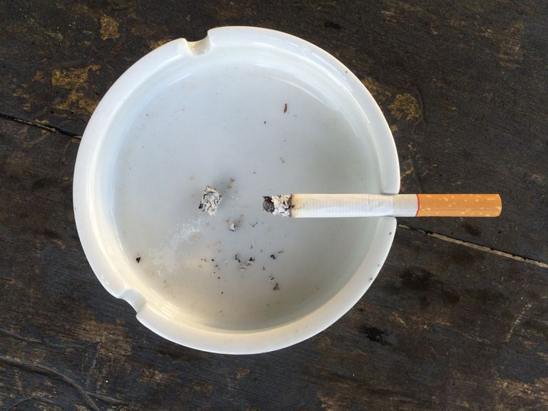 High Angle View Of Cigarette In Ashtray
