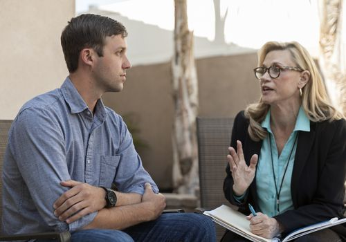 Man talking with therapist in therapy