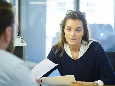 a woman talking to someone in an office
